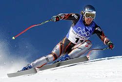 Austria's Andreas Schifferer speeds down the course during the men's Super G in Snowbasin, Utah Saturday, Feb. 16, 2002 at the Salt Lake City Olympics. (AP Photo/Alessandro Trovati)